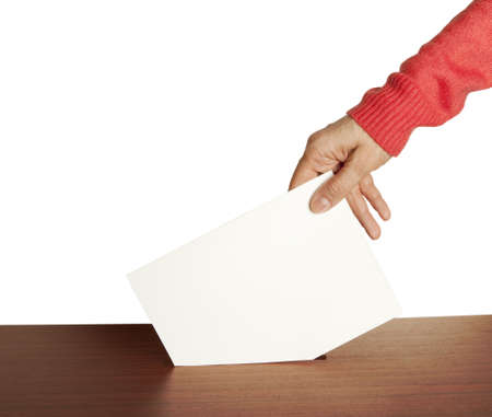 designate: Hand with ballot and box isolated on white background