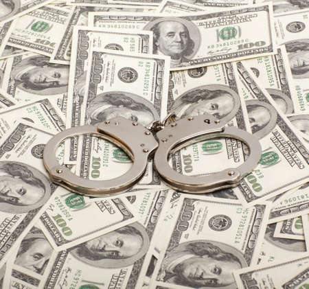 Handcuffs on money background   Criminal concepts photo