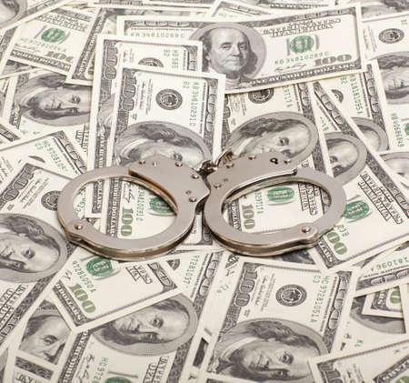 wristlets: Handcuffs on money background   Criminal concepts
