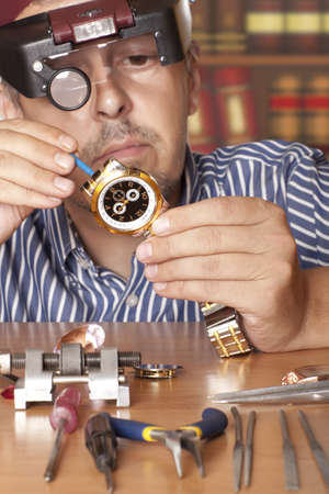 watchmaker: Watch repair craftsman repairing watch  Focus on watch