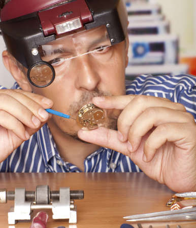 clockwork: Watch repair craftsman repairing watch  Focus on watch