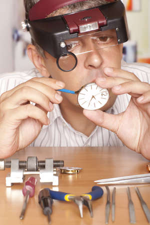 Watch repair craftsman repairing watch Focus on watch photo