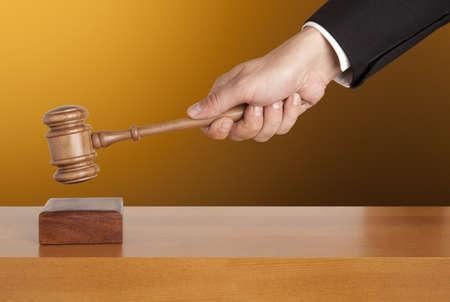 subpoena: Gavel in hand  Stock Photo