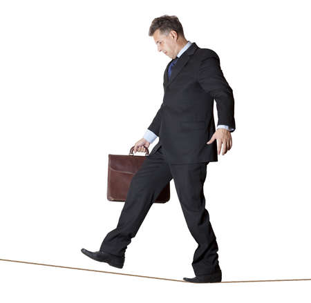 Businessman rope-walker  Isolated on white background  photo