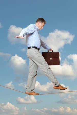 Businessman rope-walker Stock Photo - 15409753