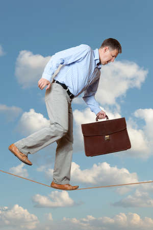 Businessman rope-walker photo
