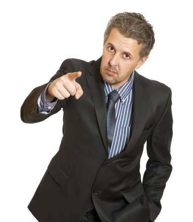 Portrait of an angry middle aged businessman in suit pointing at you isolated over white background  Stock Photo