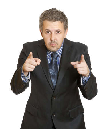 Portrait of an angry middle aged businessman in suit pointing at you isolated over white background  photo