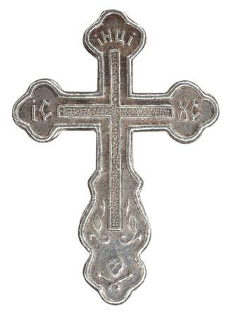 super cross: Cruz de plata con inscripciones religiosas en fondo blanco Super macro