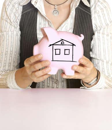 female holding piggy bank  photo