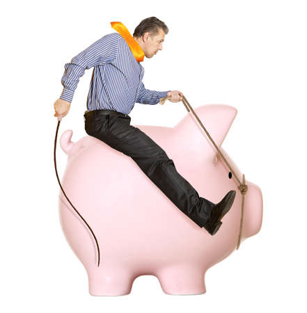 Businessman riding a piggy bank  Concept  photo