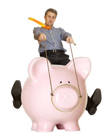 winning stock: Businessman riding a piggy bank  Concept
