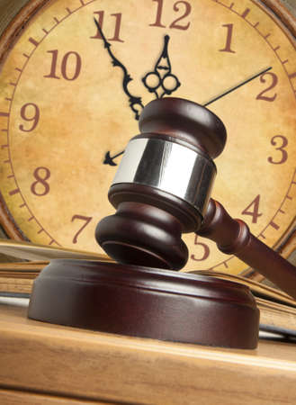 the litigation: Gavel and old clock  Stock Photo