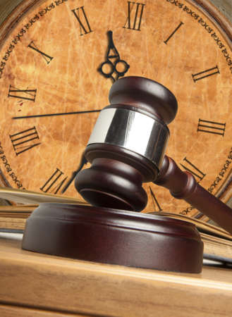 Gavel and old clock  photo