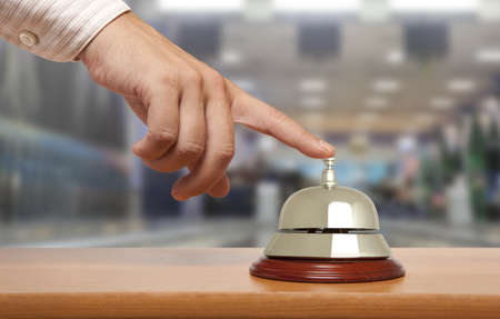 hospitality industry: Hand of a man using a hotel bell