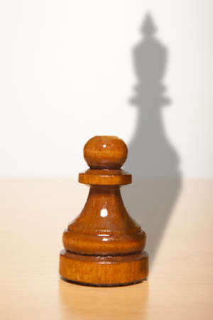 shadow puppet: Chess pawn with the shadow of a king