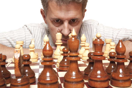 Focused man thinks on game of chess  photo