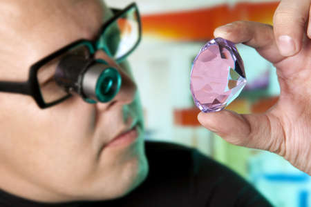 appraising: Jeweller appraising quality of diamond