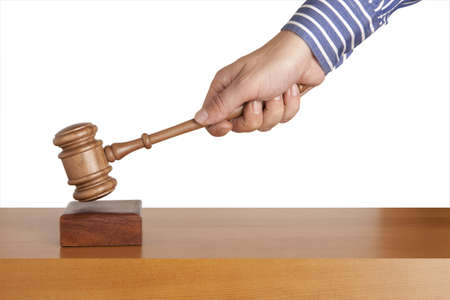 Human hand holding a wooden gavel  photo
