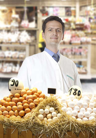 Farmer sells eggs at the market Stock Photo - 15484348