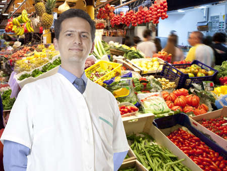 Portrait of male seller fruit looking at camera Stock Photo - 15484333