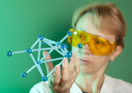 cloning: Scientist working with molecular structure