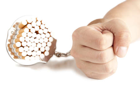 Cigarette  and  handcuffs  isolateed on white  photo