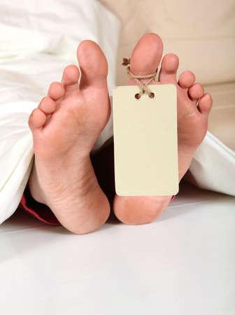 toe tag: Human feet