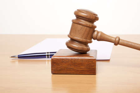 Gavel, a pen and a paper on the table Stock Photo - 15696019