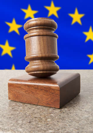 arbitrate: Gavel and Flag of Europe