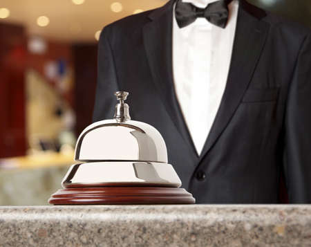 reception counter: Hotel Concierge.  Service bell at the hotel