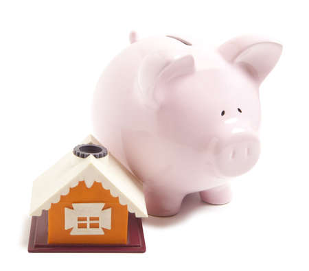 Piggy bank with small model house isolated  photo
