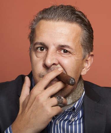 scheming: Man wearing suit gangster style smoking cigar  Stock Photo