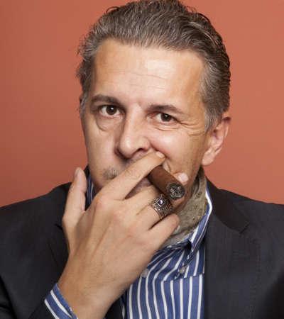 smoking cigar: Man wearing suit gangster style smoking cigar