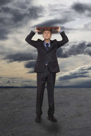 loss leader: Businessman with briefcase under a stormy sky