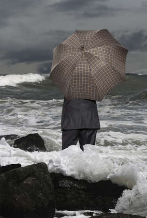 Economic crisis. Businessman with umbrella photo