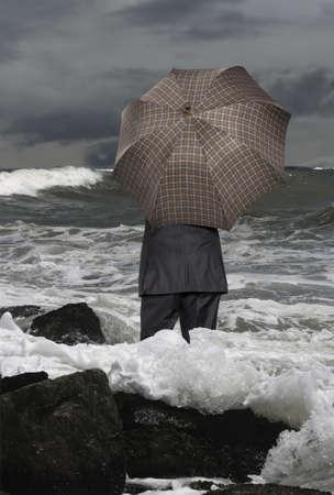 Economic crisis. Businessman with umbrella Stock Photo - 16015974