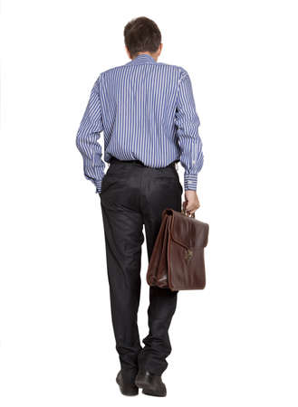 Back view of a walking business man holding a briefcase on white background  photo