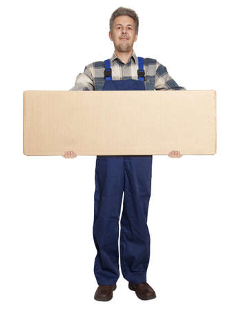 Handsome worker with a box. Isolated over white background  photo
