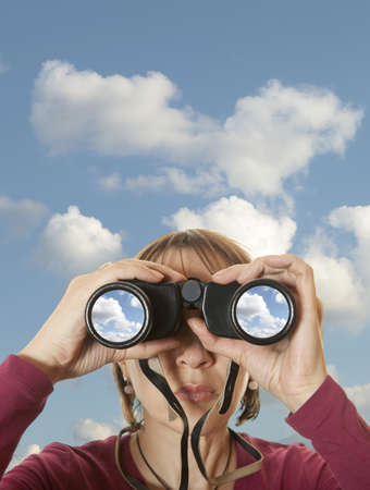 search solution: Attractive woman with binoculars in the sky