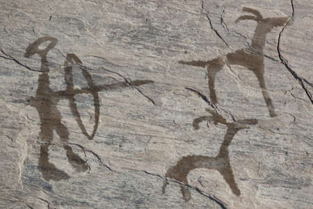 mural: Old ancient petroglyph. Bronze age  Stock Photo