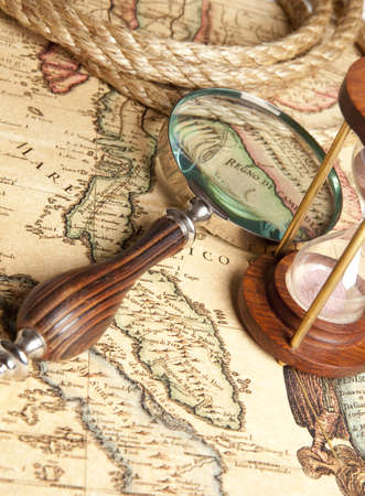 Magnifying glass and ancient old map Stock Photo - 17341995
