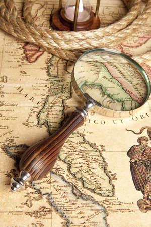 Magnifying glass and ancient old map photo
