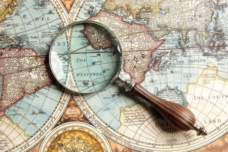 world globe map: Magnifying glass and ancient old map