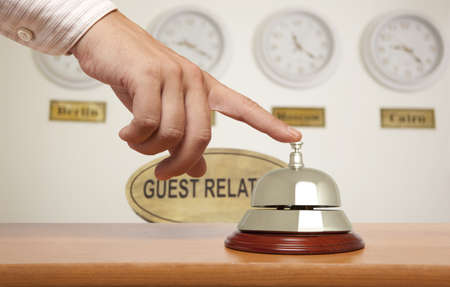 call bell: Hand of a man using a hotel bell  Stock Photo