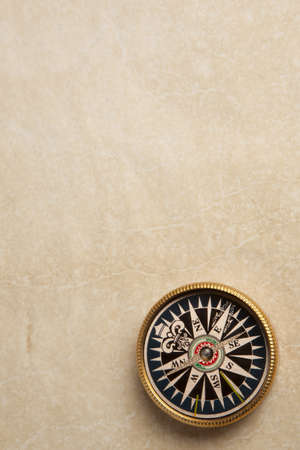 Close up view of compass on vintage paper Stock Photo - 17371523