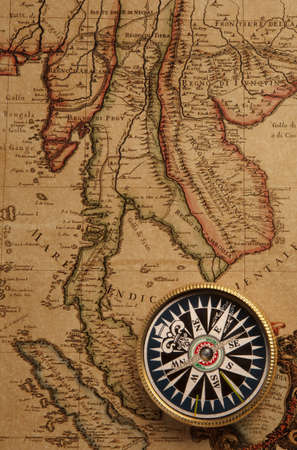 old compass and rope on vintage map  Stock Photo - 17357684