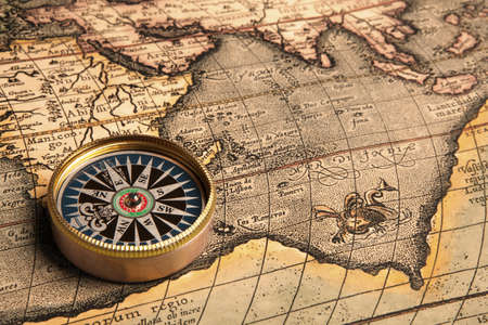 Old compass and rope on vintage map Stock Photo - 17421778