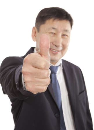 Happy asian business man going thumbs up. Isolated on white background photo