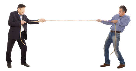 Two adult businessman pull the rope Stock Photo - 17542310